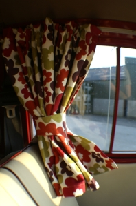 VW Campervan Curtains in Clarke and Clarke Anja Summer fabric in a splitscreen van