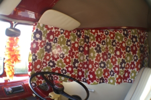 VW Campervan Curtains in Clarke and Clarke Anja Summer fabric in a splitscreen van with a lei