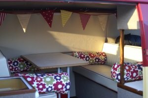VW Campervan Curtains and cushions in Clarke and Clarke Anja Summer fabric in a splitscreen van interior with bunting