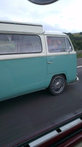 turquoise white bay window camper motorway