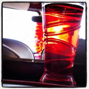Pint of cider inside a split screen camper van