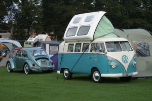 turquoise splitscreen vw camper field of dreams