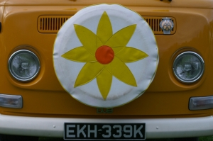 vw bay window orange camper flower spare tyre field of dreams